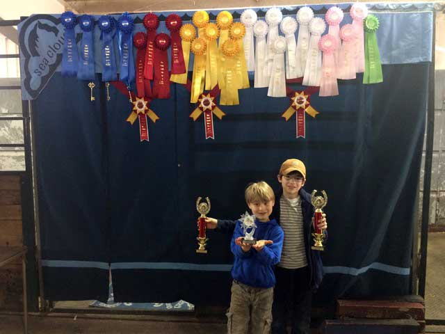 showing off Jakob's loot in front of our Key Classic ribbon display